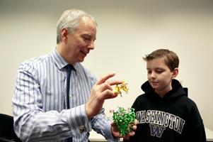 Dr. Jim Olson showing child a brain model