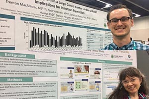 Trent MacAllister and Julie Knight present their abstracts at APIC's annual conference in Portland, Oregon.